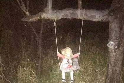 swinging doll